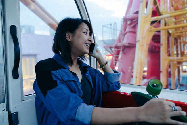 Asian girl looking at panorama from Kobe ferris wheel