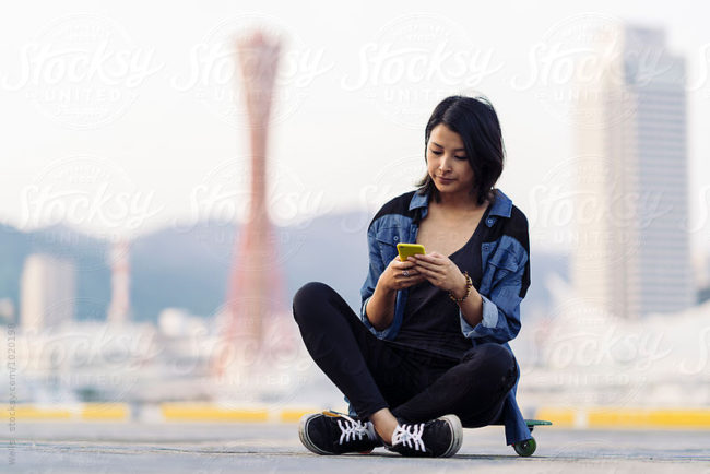 Young asian woman using a smartphone