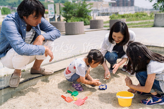 Japanese family together in a park in Japan