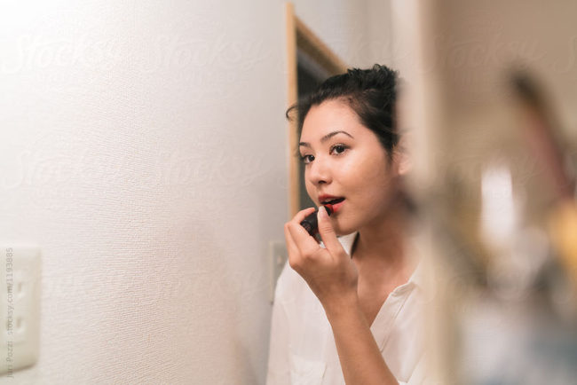 Attractive japanese woman getting ready before going out