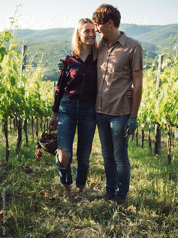 Young couple wotking in the vineyard