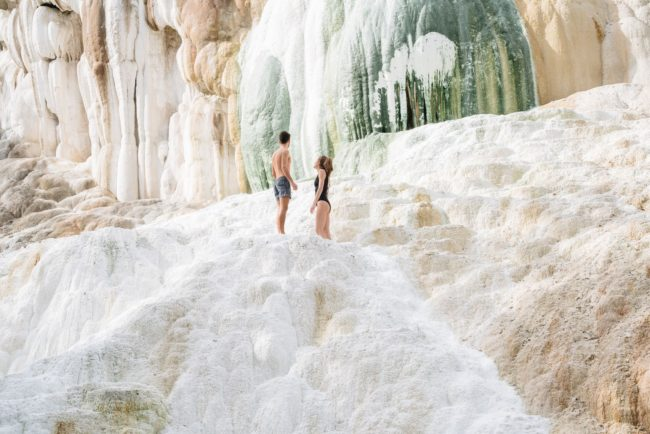 Couple relaxing in natural hot springs
