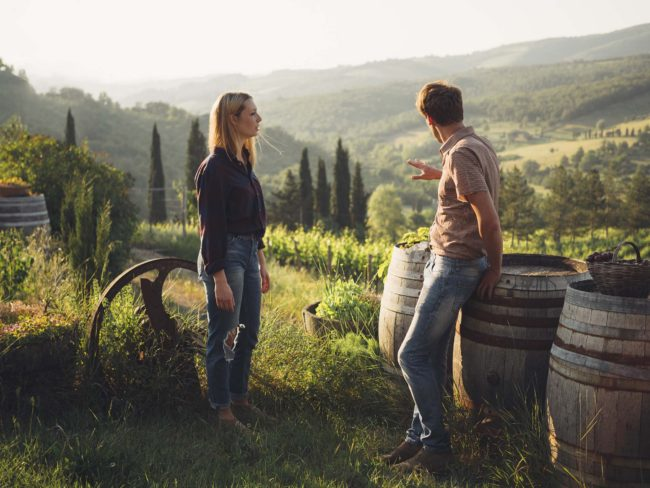 Young couple working in the vineyard