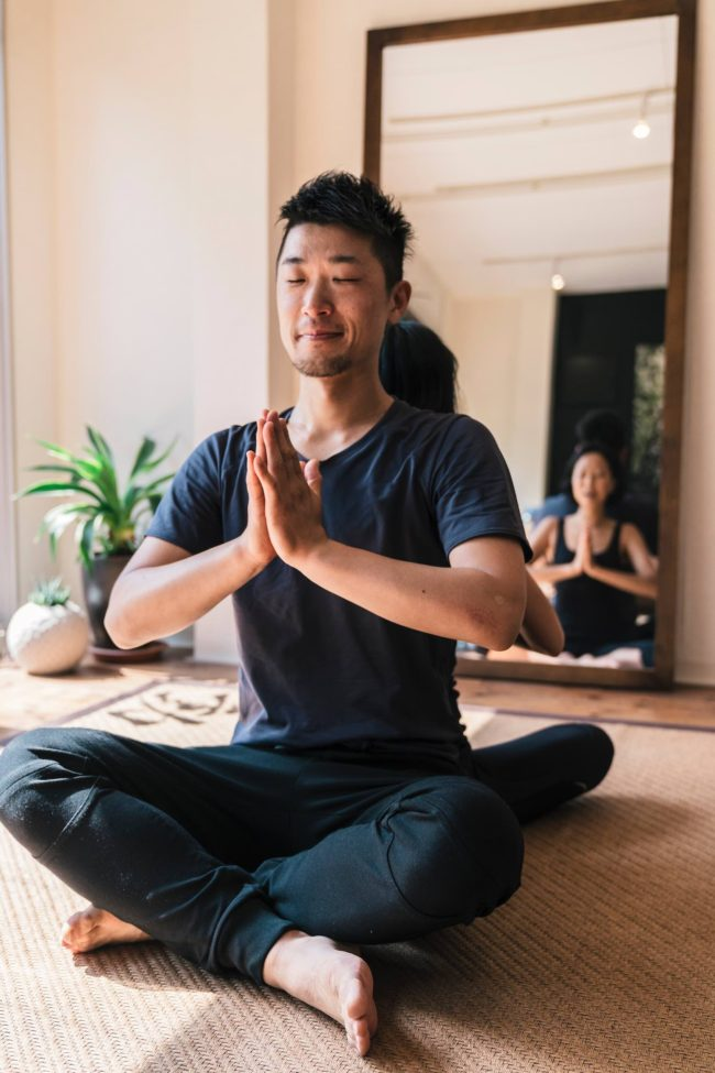 Couple doing yoga in Japan