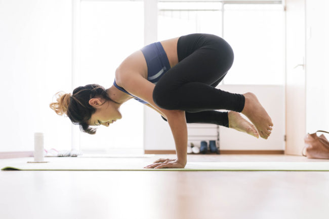 Young Japanese woman doing yoga at home